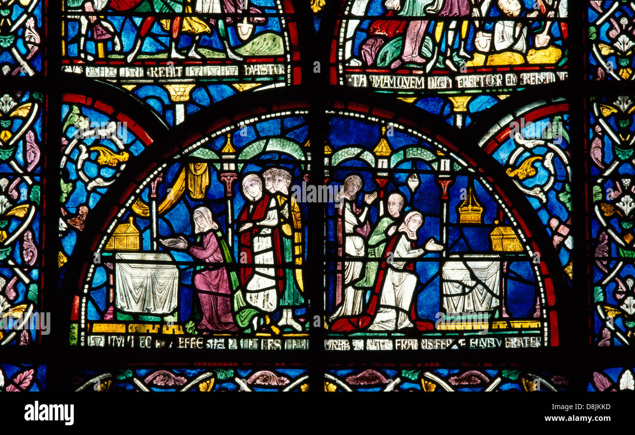 Medieval (C13th) stained glass in the Trinity Chapel of Canterbury Cathedral, depicting two views of worshippers - Stock Image
