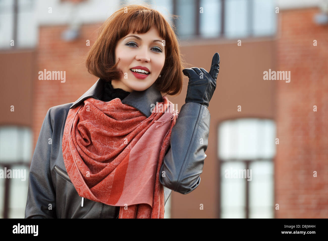 Young woman with a finger pointing up - Stock Image