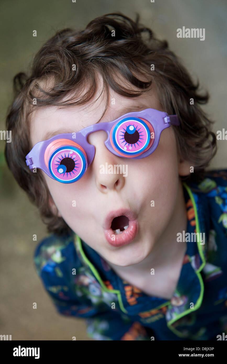 Boy wearing novelty glasses - Stock Image