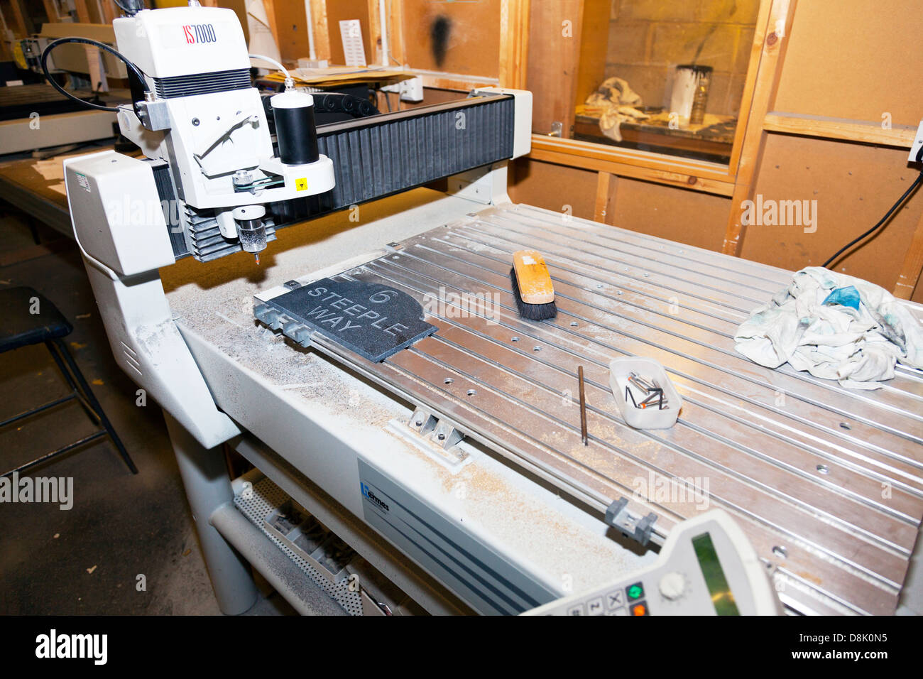 Slate engraving engraver machine Charles Birch Ltd Warehouse - Stock Image