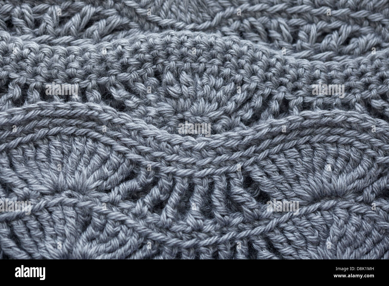 Taupe brown crocheted wool yarn closeup as background texture - Stock Image