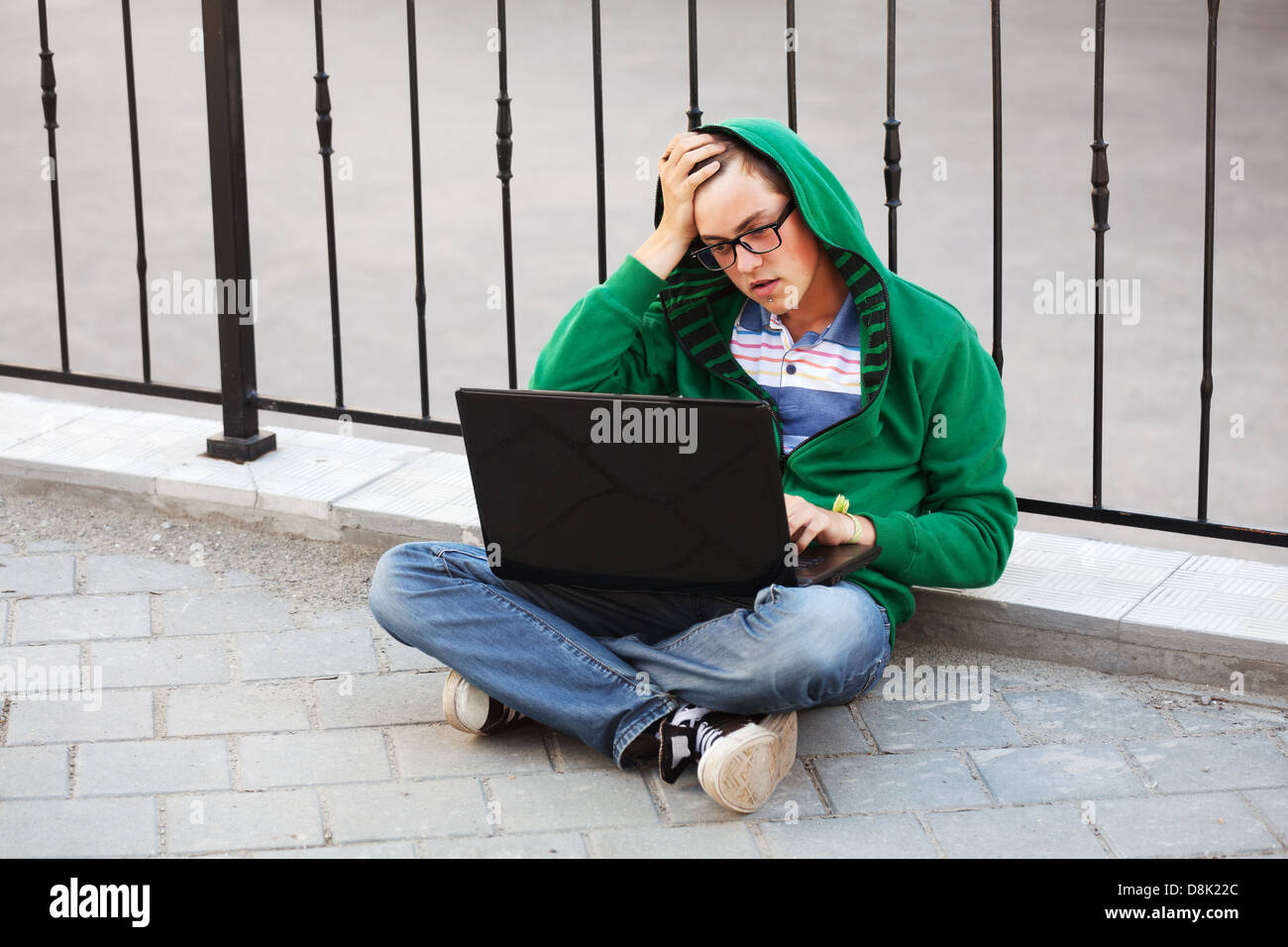 Young student using laptop - Stock Image