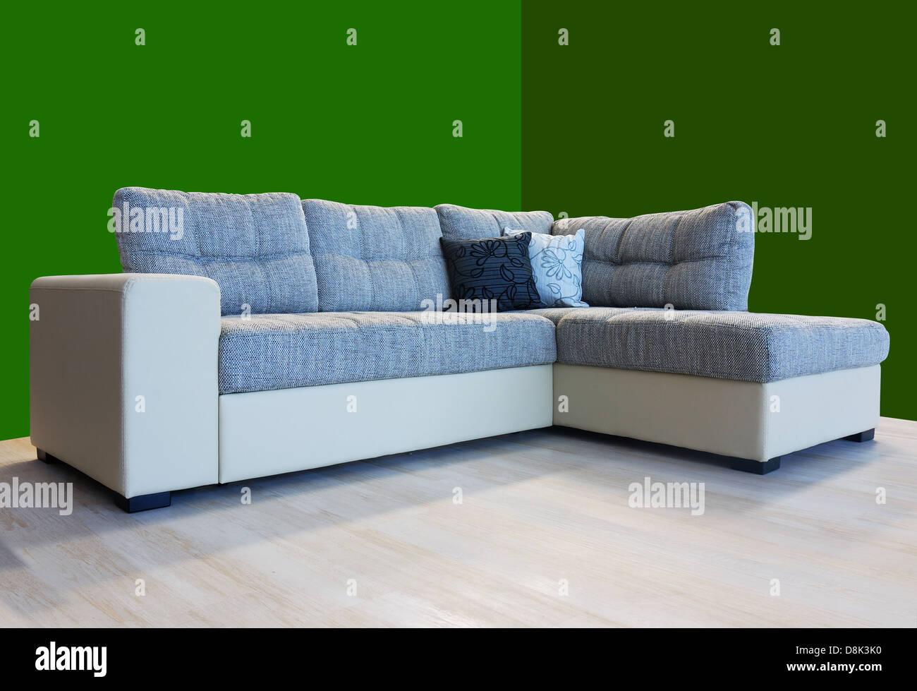 L shape fabric four sitter sofa, grey color - Stock Image
