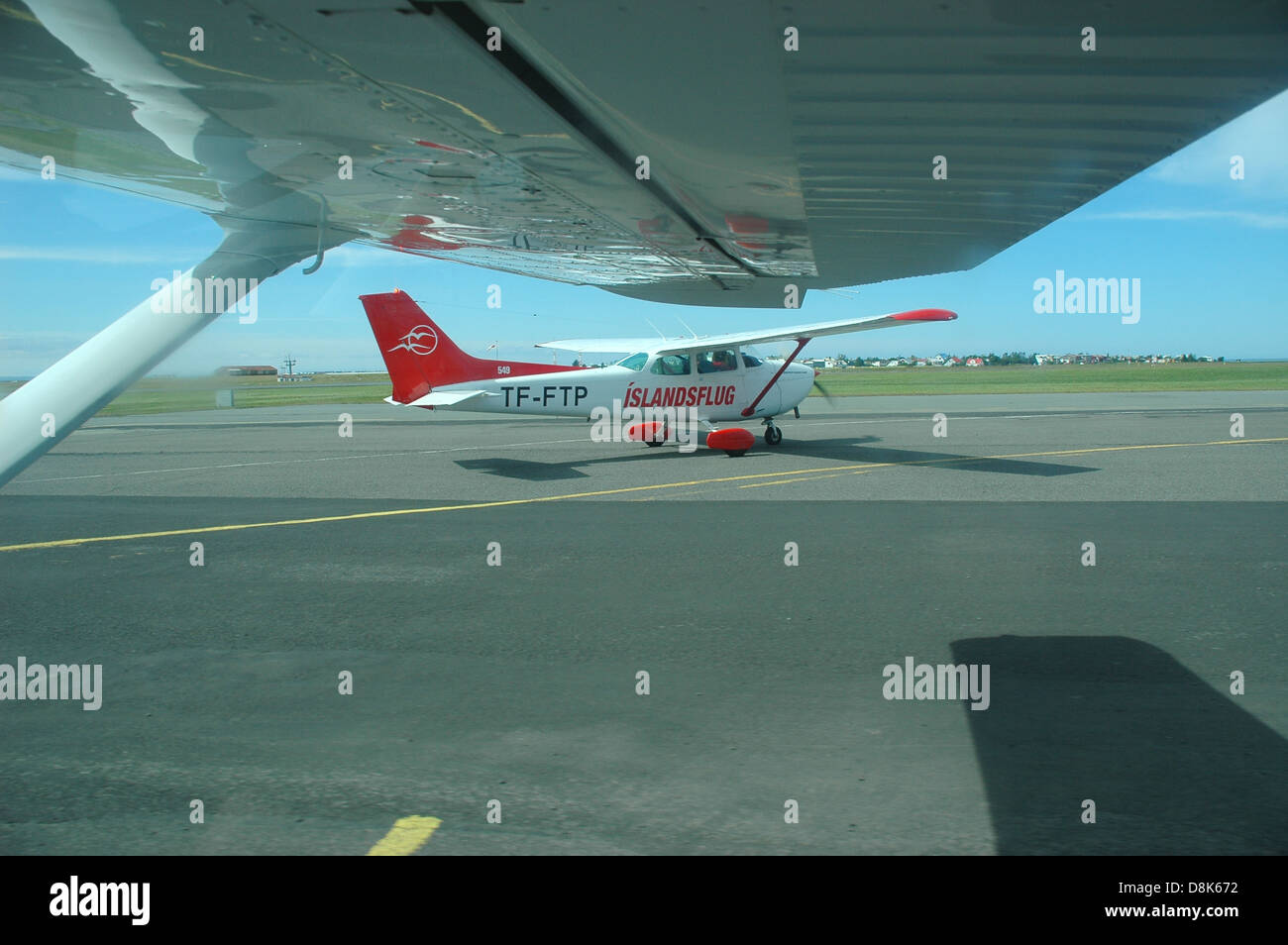 Taxiing in a light aircraft at Reykjavik airport on a sightseeing flight in Iceland. Another plane is taxiing ahead - Stock Image