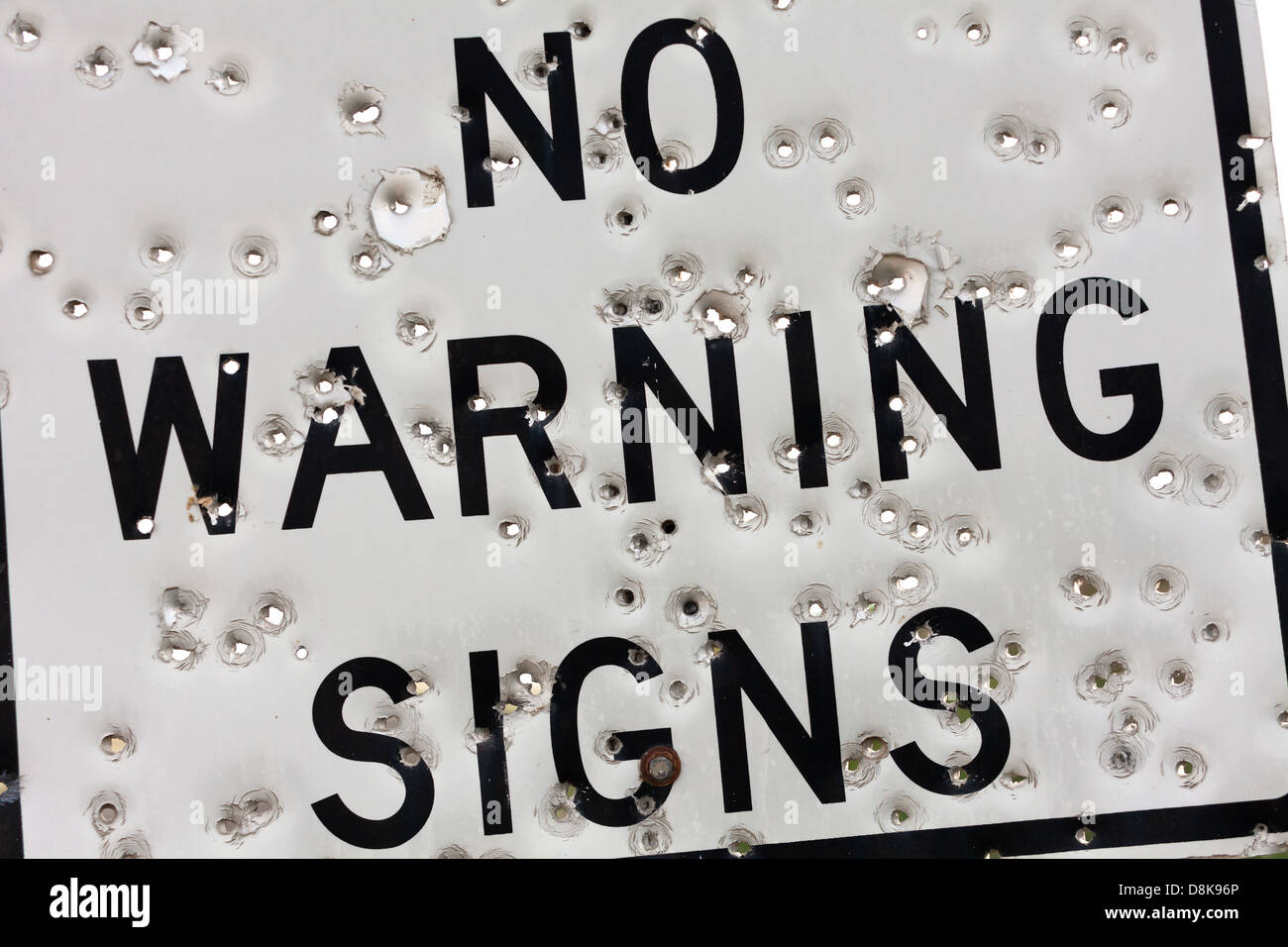 Warning Sign with Bullet Hole - Stock Image