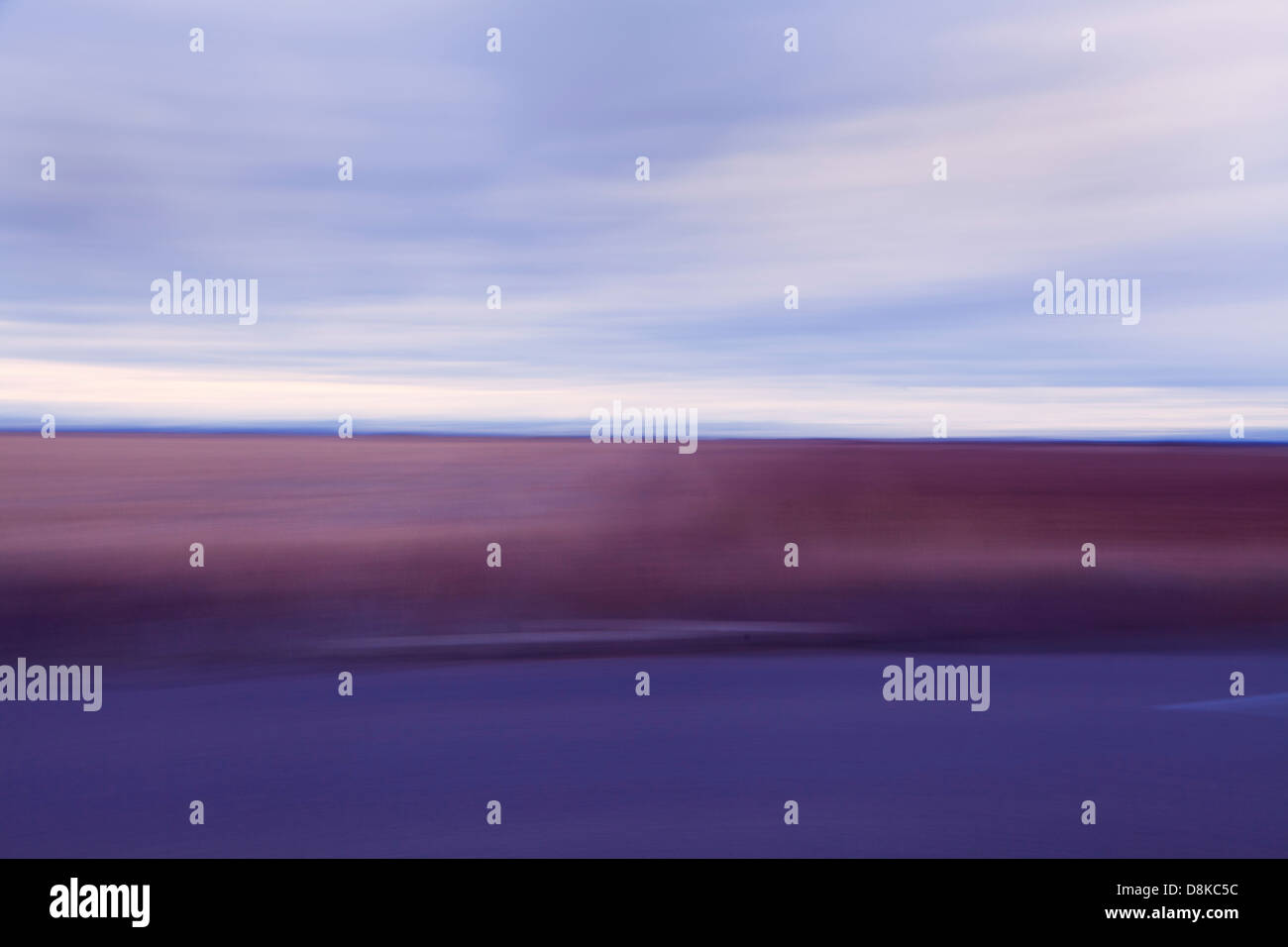 taken at dawn, an abstract photo of the Spanish Prairies known, the meseta. a blur of the colors, blue and pink - Stock Image