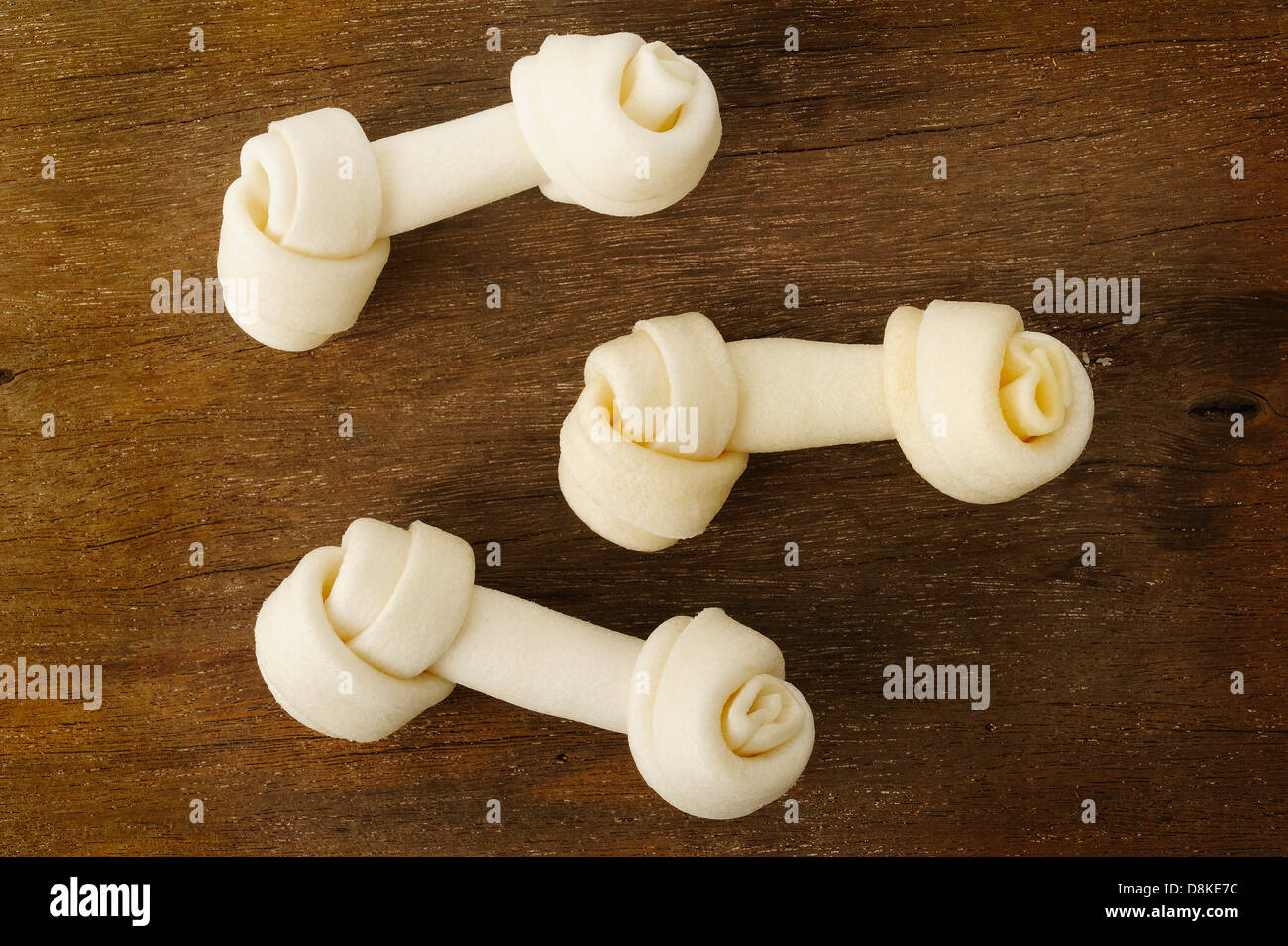 Bone toy for dogs on wooden background - Stock Image