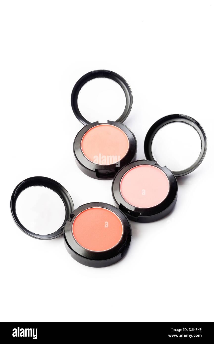 makeup brush and powder on white background - Stock Image