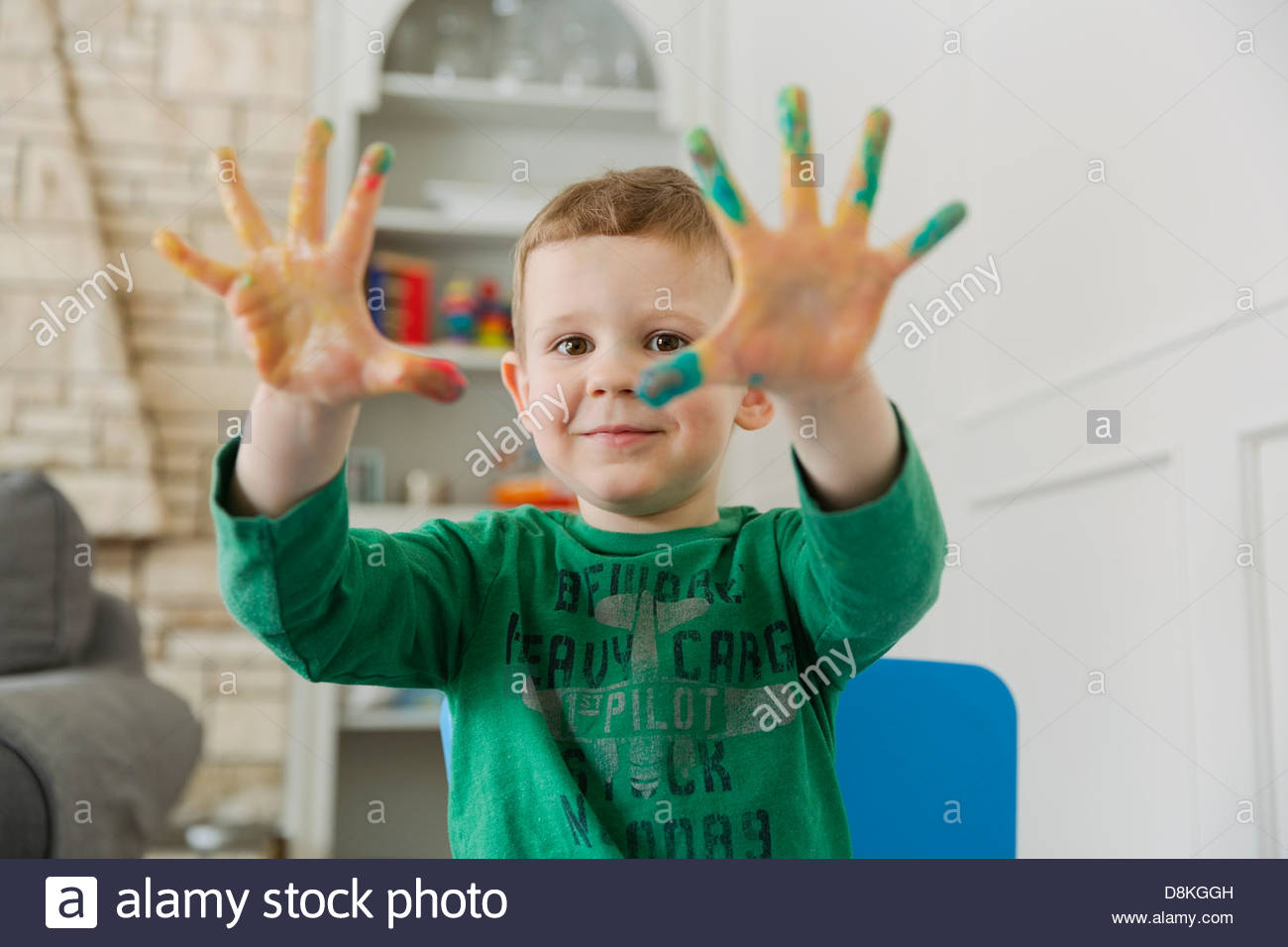 Portrait of boy finger painting at home - Stock Image