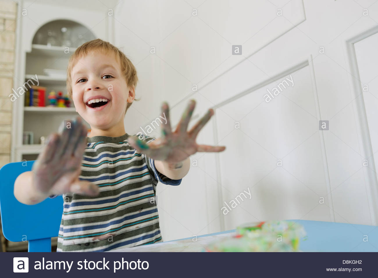 Portrait of boy finger painting - Stock Image