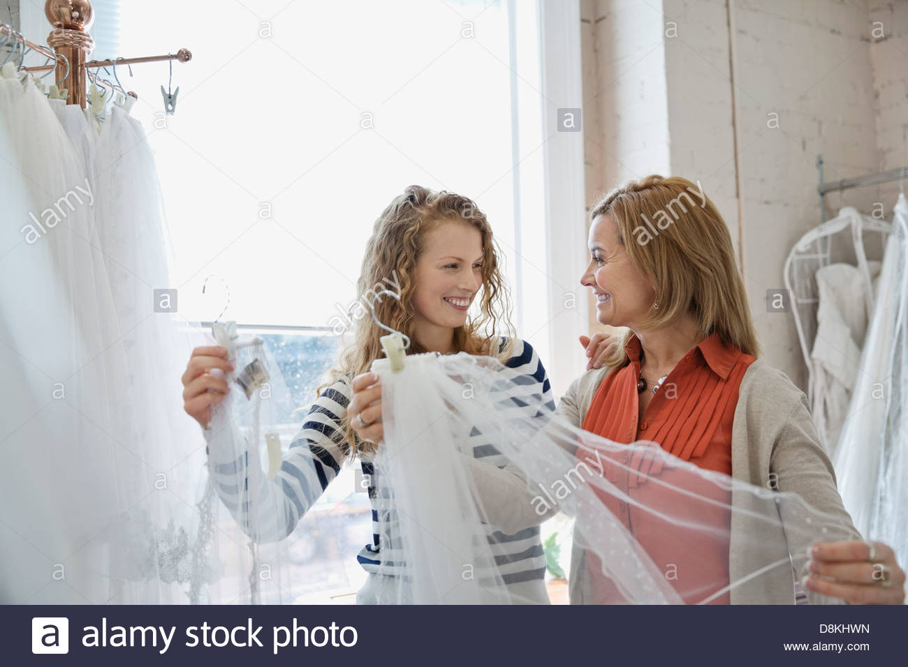 Mother and daughter shopping at bridal store - Stock Image