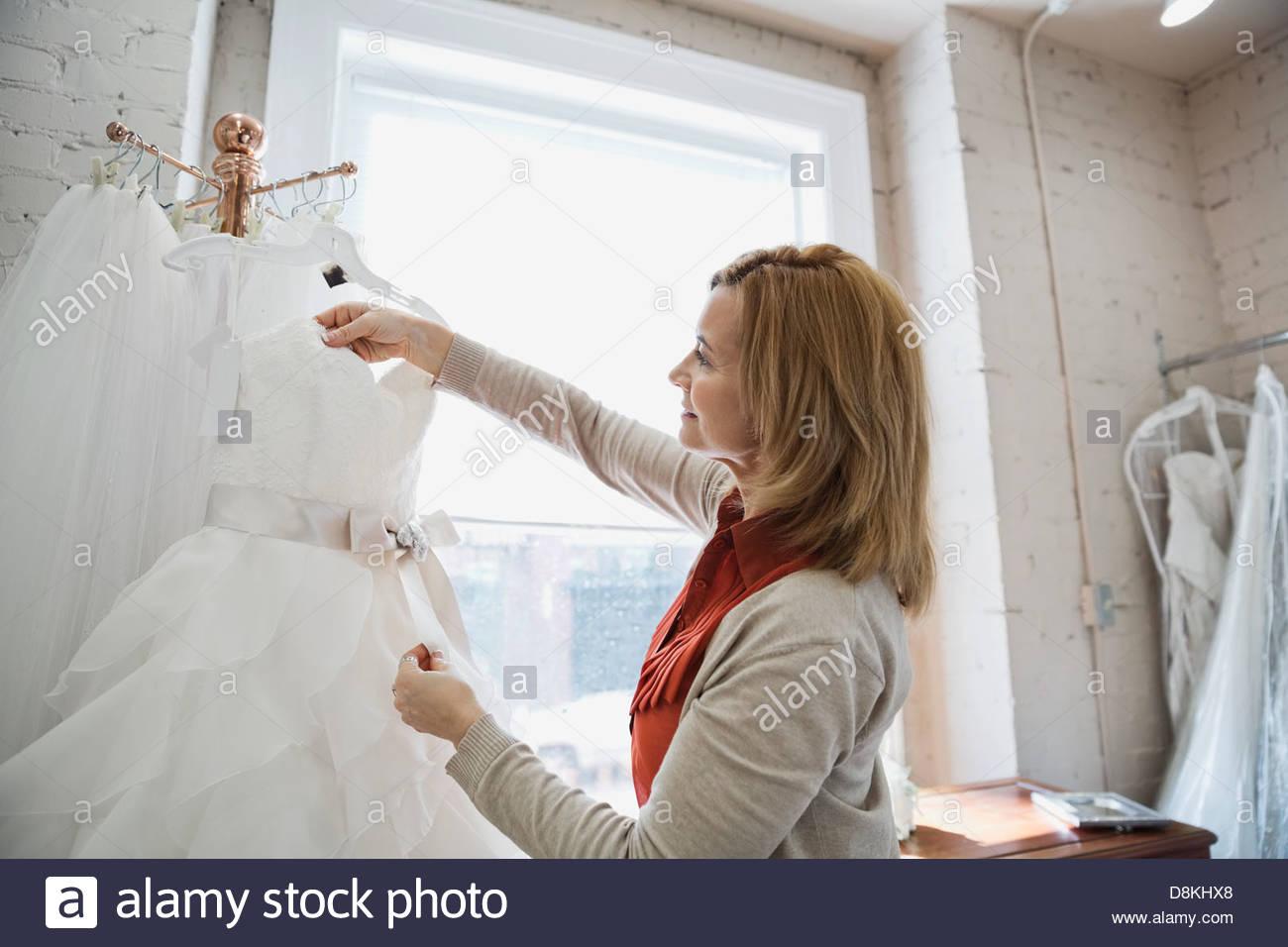 Woman shopping at bridal store - Stock Image