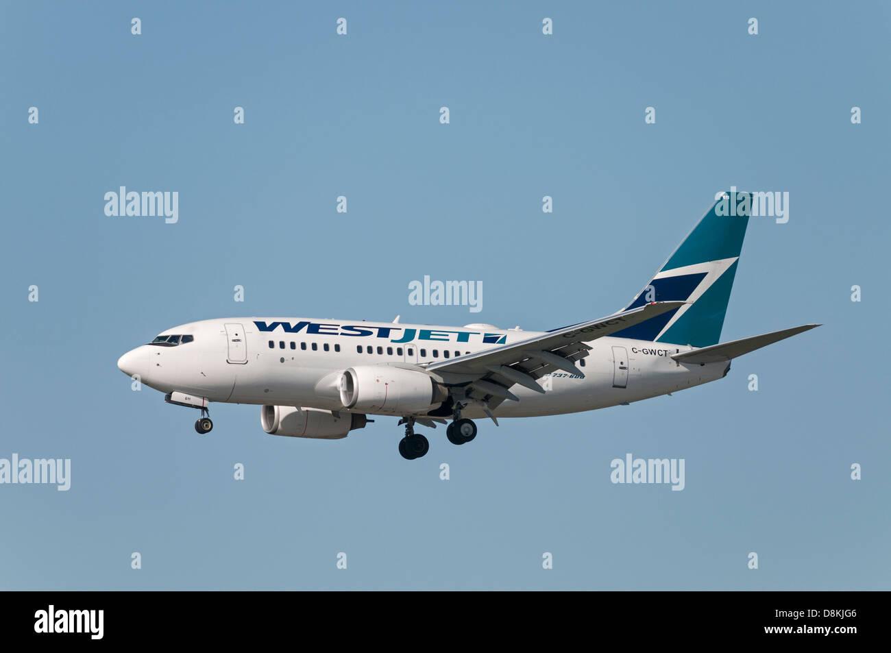 Westjet Boeing 737 passenger jetliner on final approach for landing. - Stock Image
