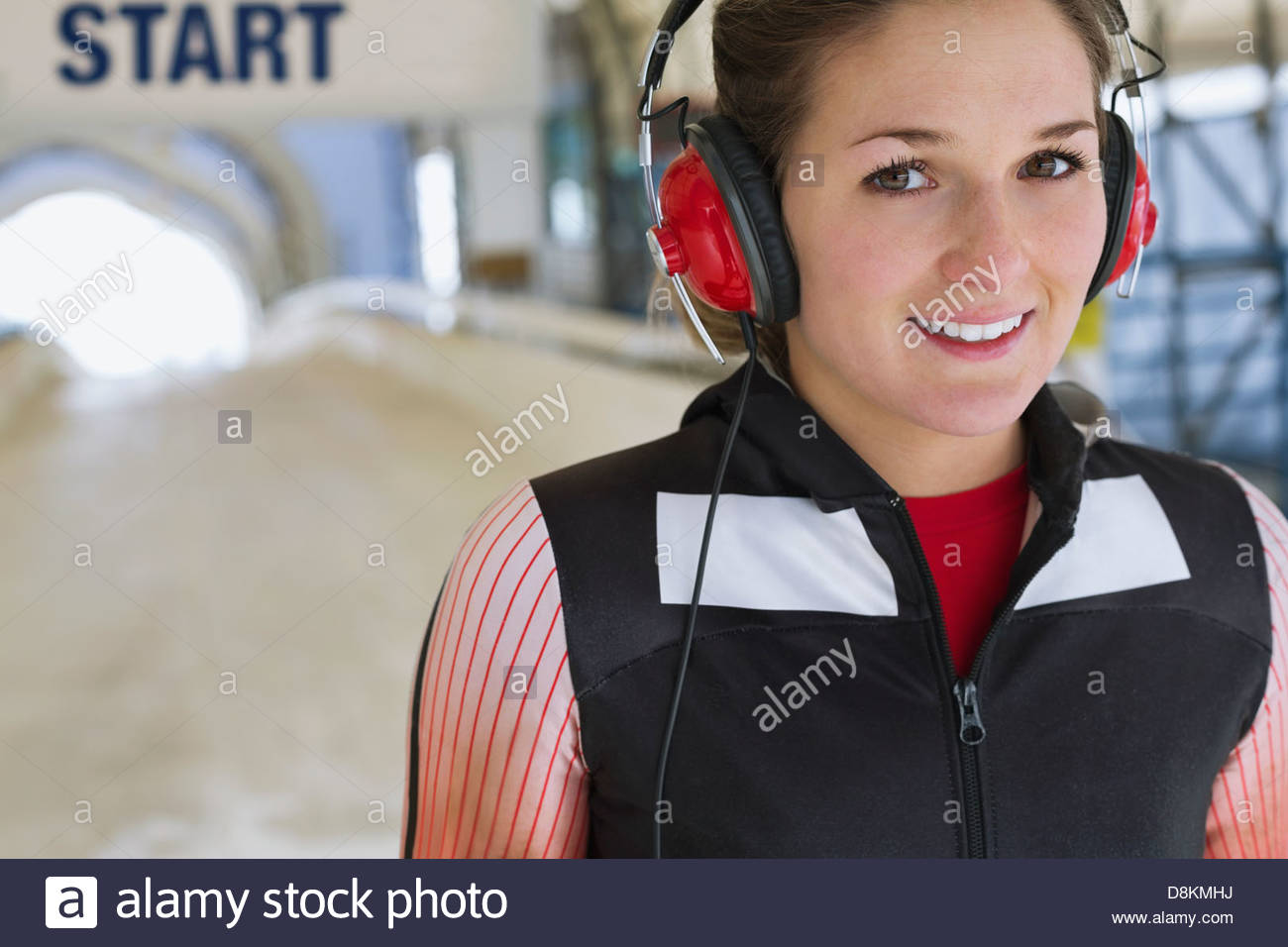 Portrait of female skeleton athlete preparing for race - Stock Image