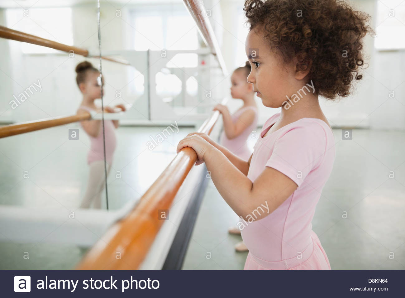 Girls practicing ballet in ballet studio - Stock Image