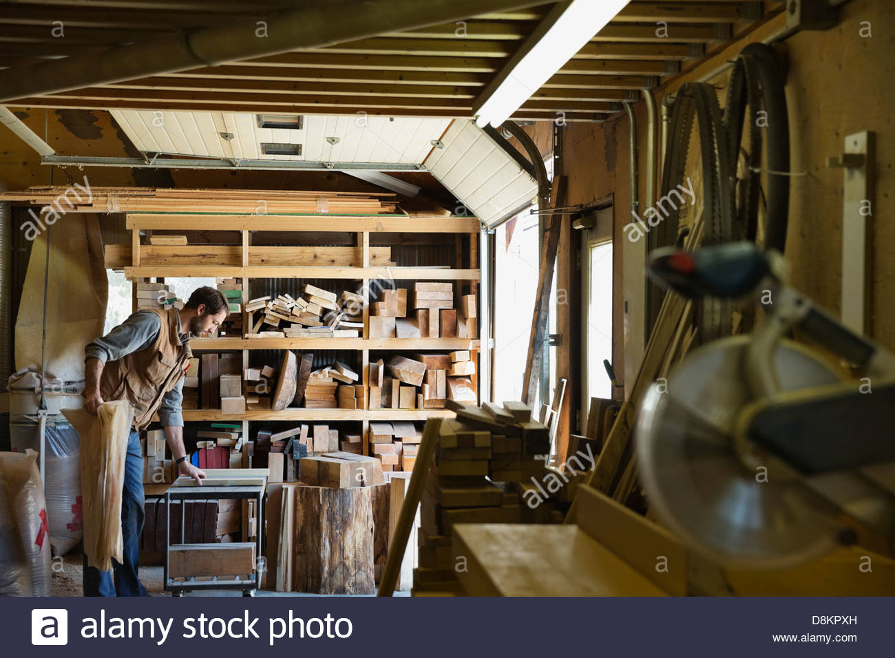 Woodworker organizing equipment in workshop Stock Photo