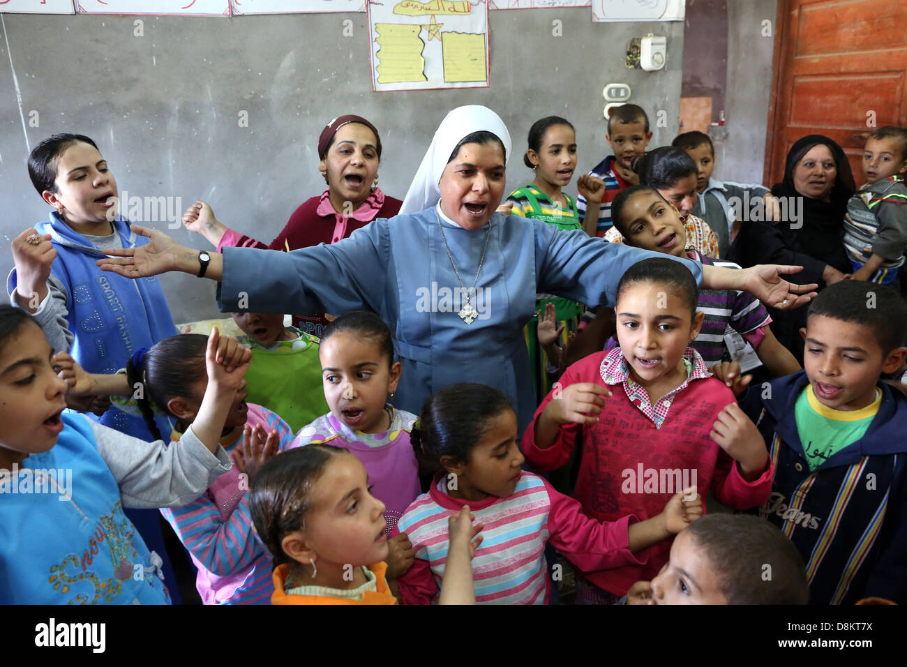Egypt, christian religious education by a catholic coptic Nun (Sister) in a private household in Upper Egypt - Stock Image