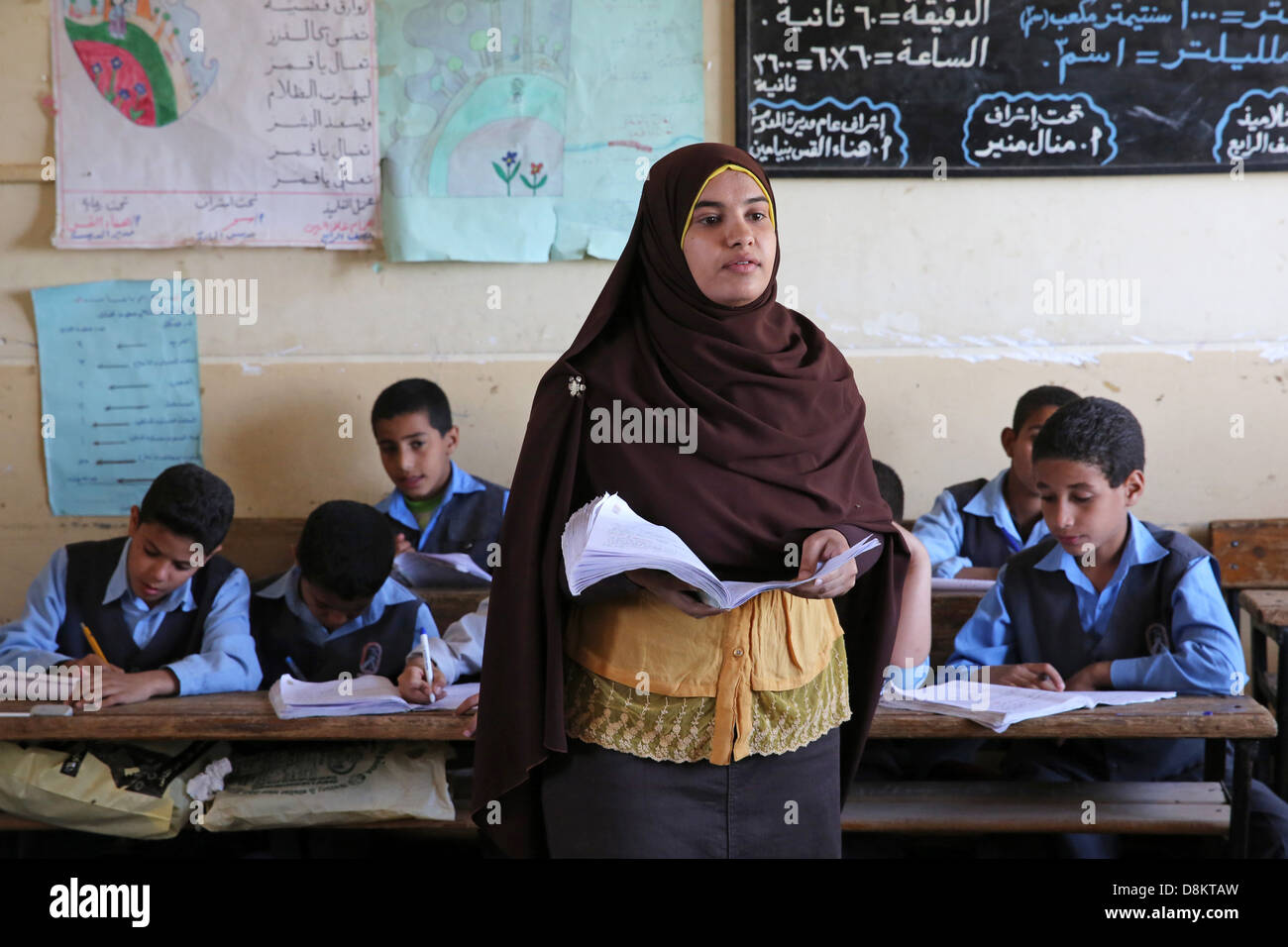 female muslim teacher in a catholic coptic shool in the Diocese of Asyut, Upper Egypt - Stock Image