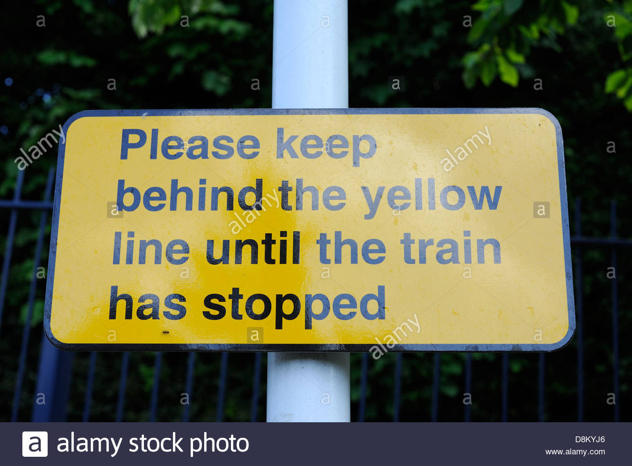 Sholing Southampton UK Station sign Please wait behind the yellow line until the train has stopped. - Stock Image
