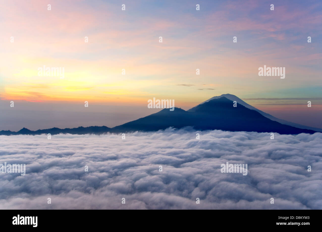 sunrise above clouds with a mountain volcano view mt batur bali