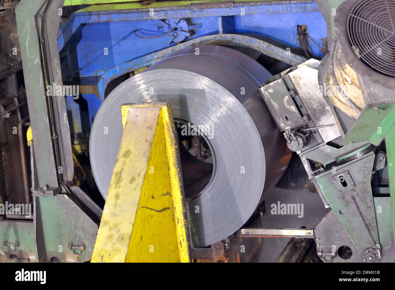 hot rolls of tinplate shoot in the plant - Stock Image