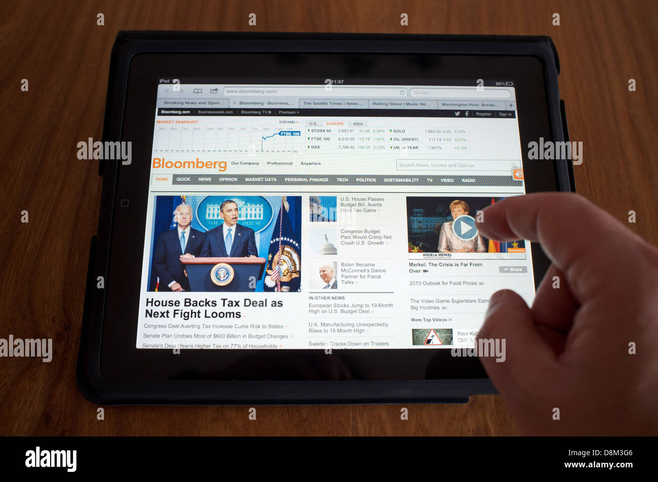 Bloomberg displayed on a tablet computer - Stock Image
