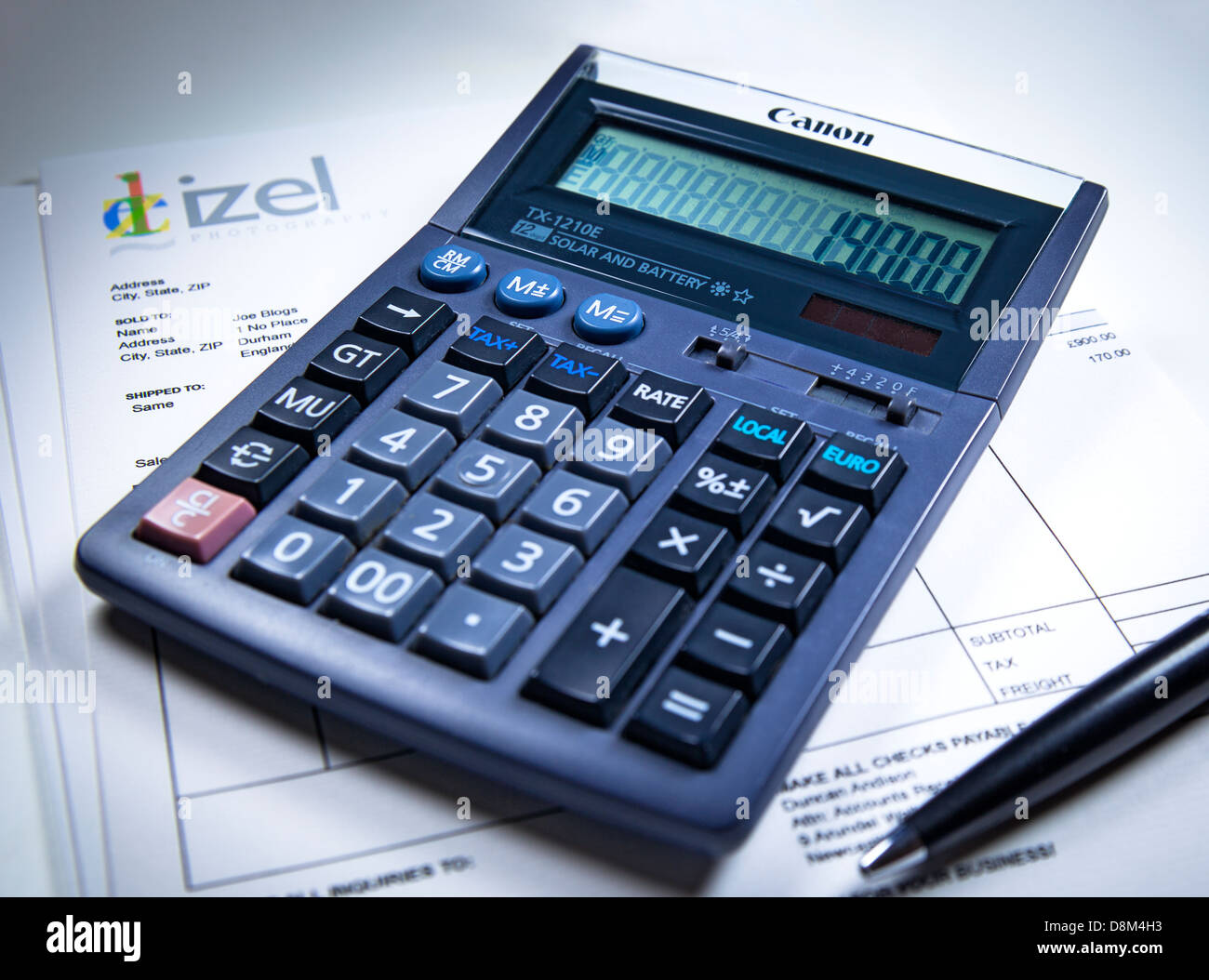 An invoice, pen and calculator Stock Photo