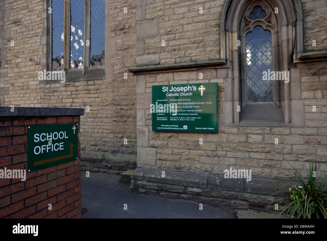 the notice-board and sign for the school office outside St Joseph's Catholic Church in stockport,greater manchester, - Stock Image