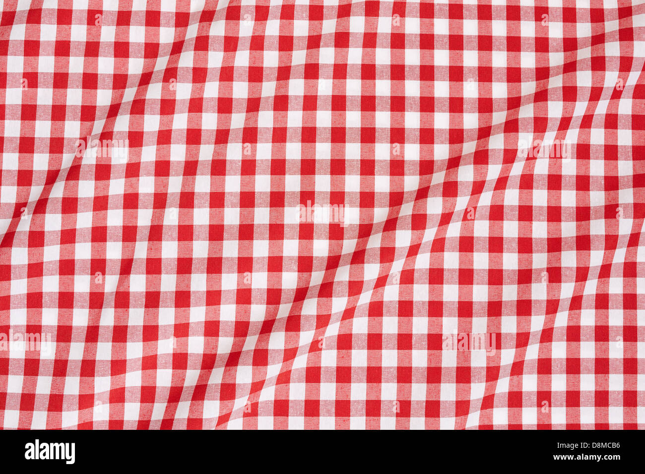 Red and white wavy gingham tablecloth texture background - Stock Image