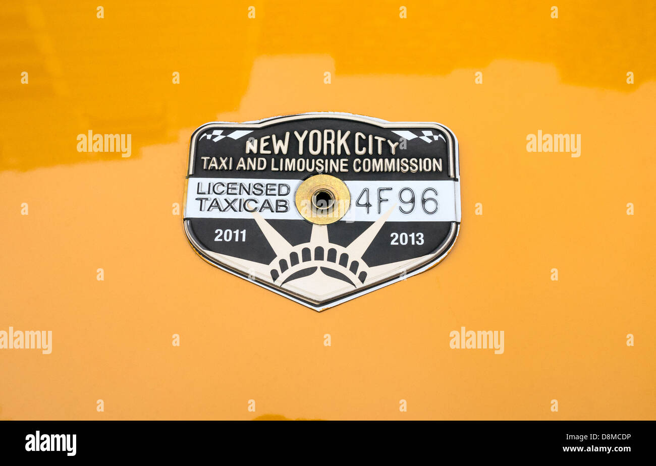Licensed yellow taxi medallion. - Stock Image