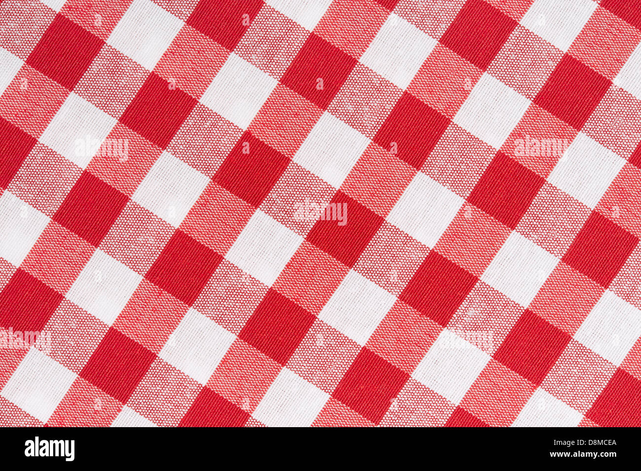 Red and white gingham tablecloth diagonal texture background - Stock Image