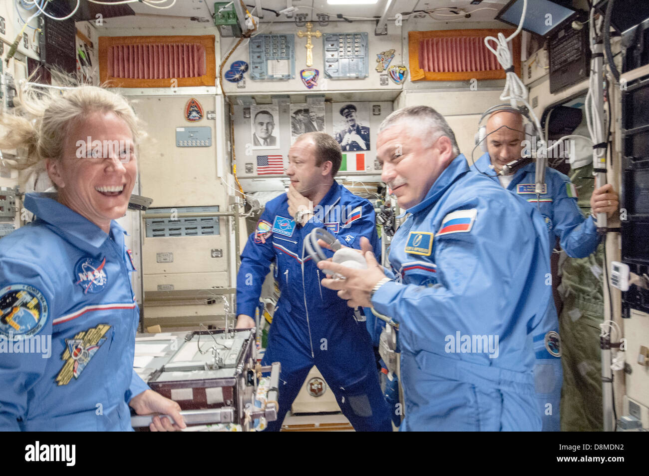 ISS Expedition 37 crew members are welcomed onboard the Zvezda service module by Expedition 36 crew members already - Stock Image