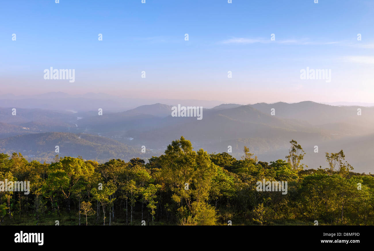 View across the Cardamom Hills near Periyar Wildlife Sanctuary at sunset and photographed from a peak near Kumily, - Stock Image