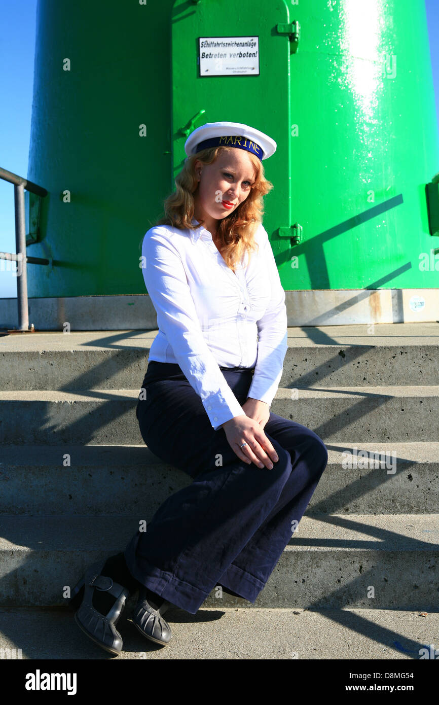 ginger woman in sailor's outfit - Stock Image