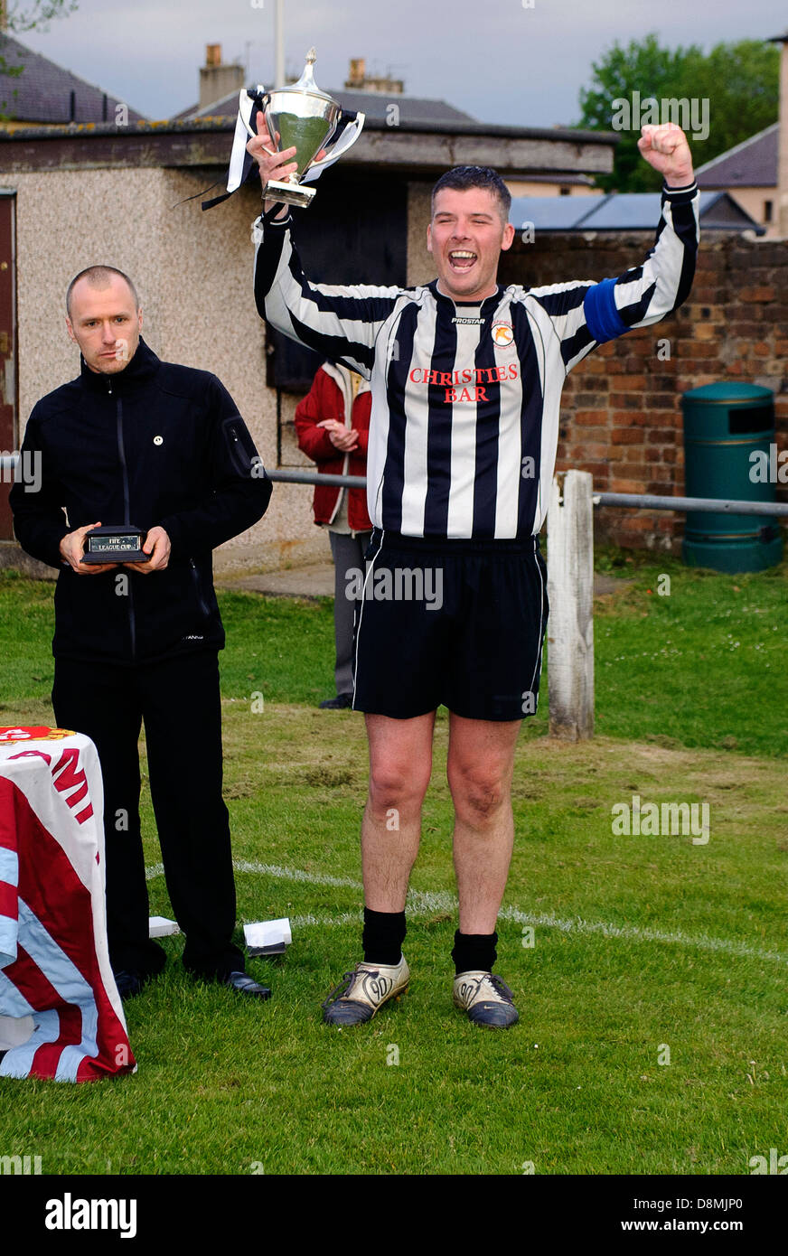 Jeanfield captain John Anderson lifts the ACA Cup - Stock Image