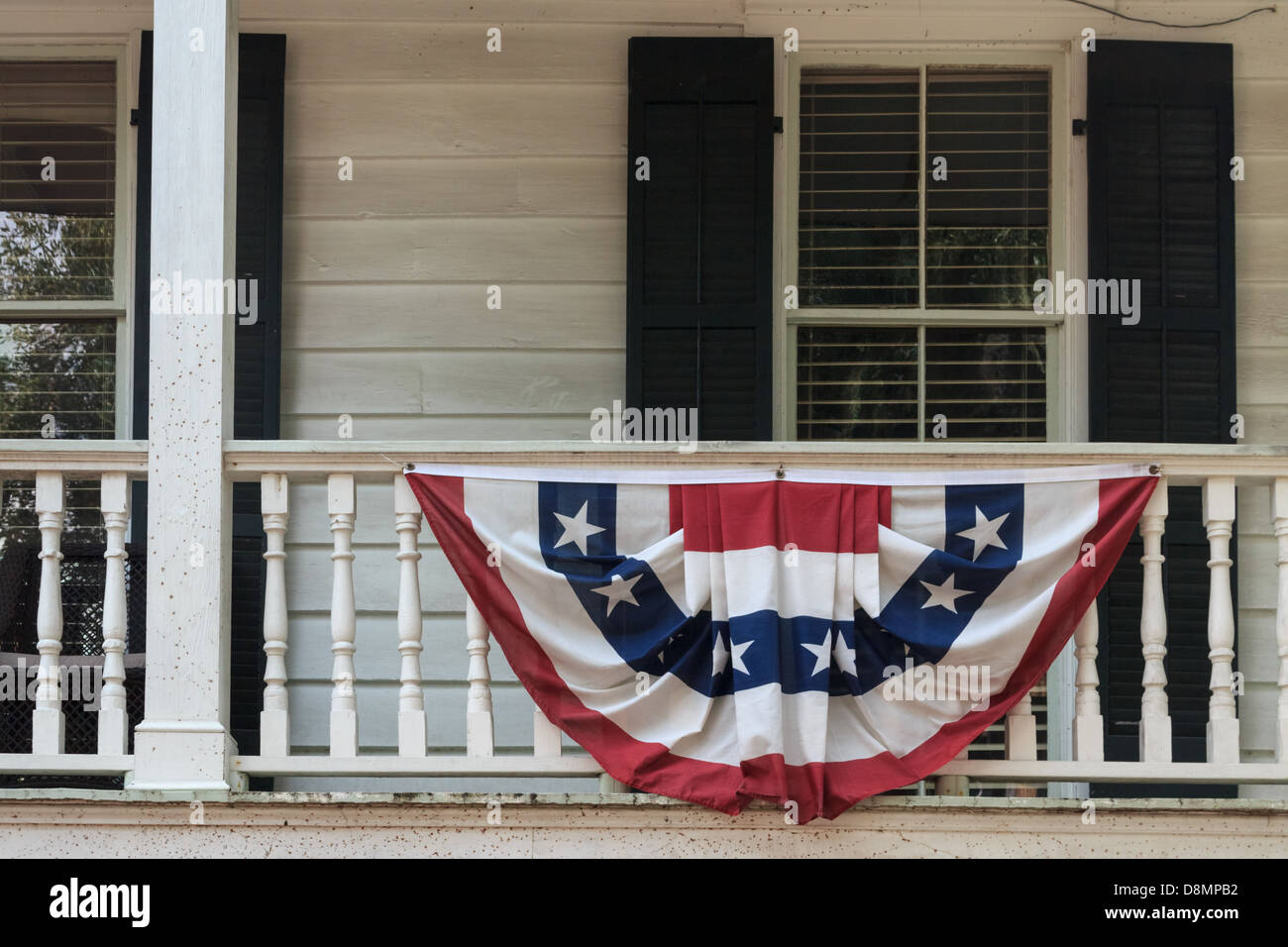 A shabby southern states hut and house with a flag in american colors - Stock Image