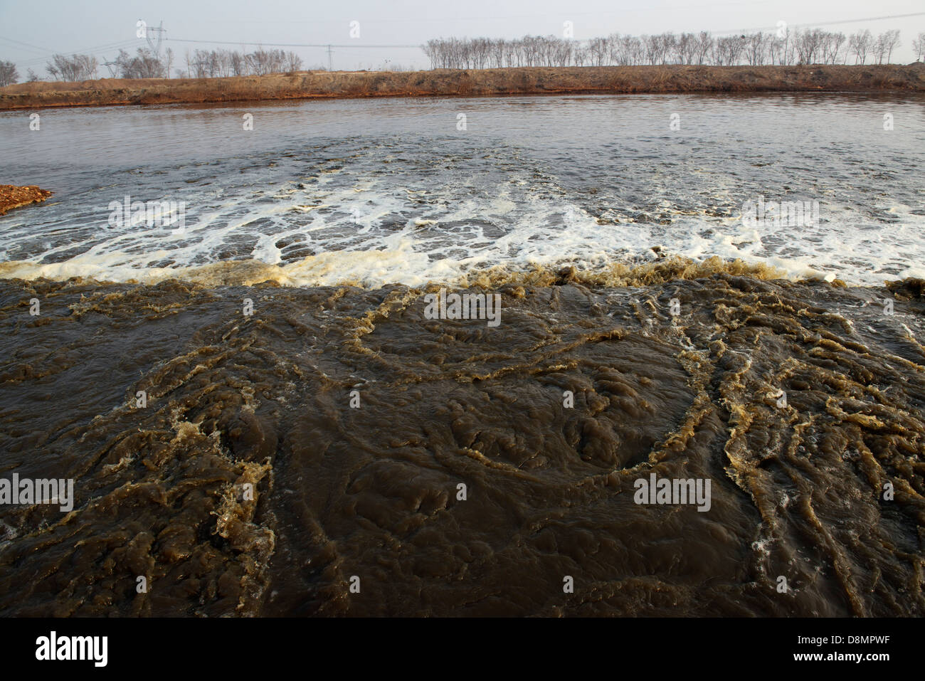 Untreated industrial waste water is discharged directly into Zhongting River in Shengfang, Langfang, Hebei province, - Stock Image