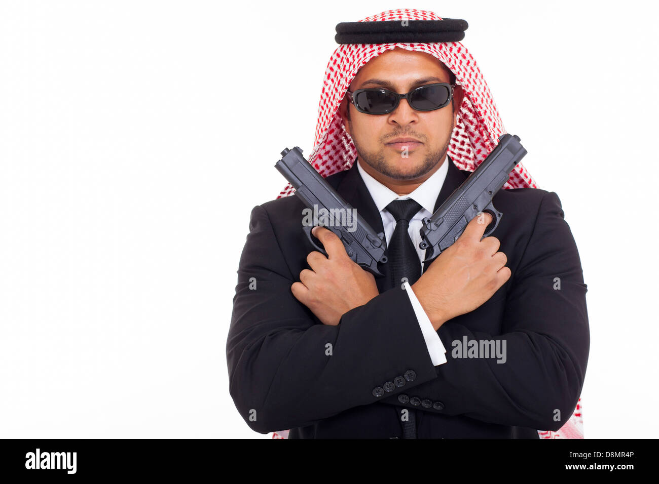 arabian mafia man holding pistols over white background - Stock Image