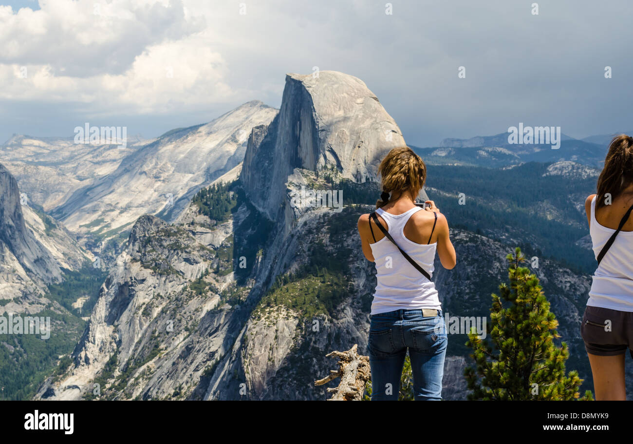 People Enjoying The View Of Half Dome From Glacier Point