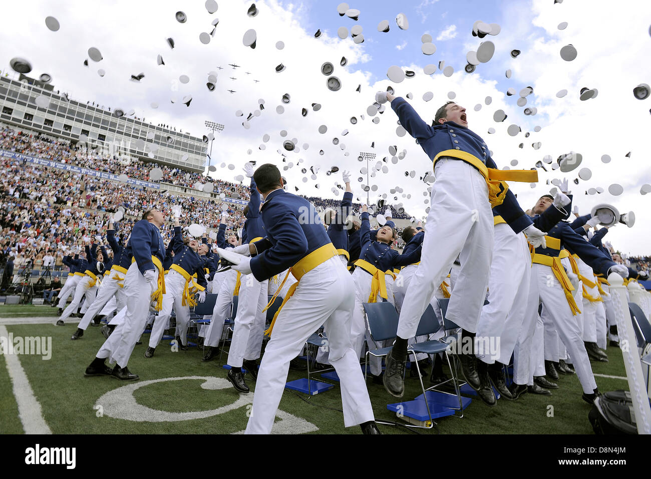 Newly minted second lieutenants of the US Air Force Academy Class of 2013 toss their hats in the air at graduation - Stock Image