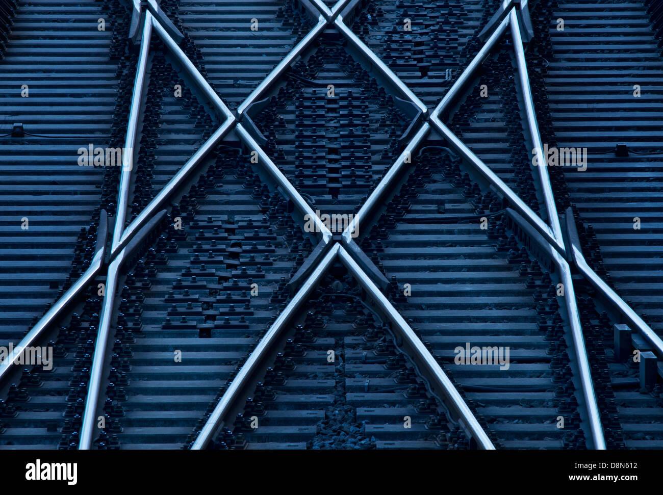 Crossing railway tracks. Rotterdam, The Netherlands. - Stock Image