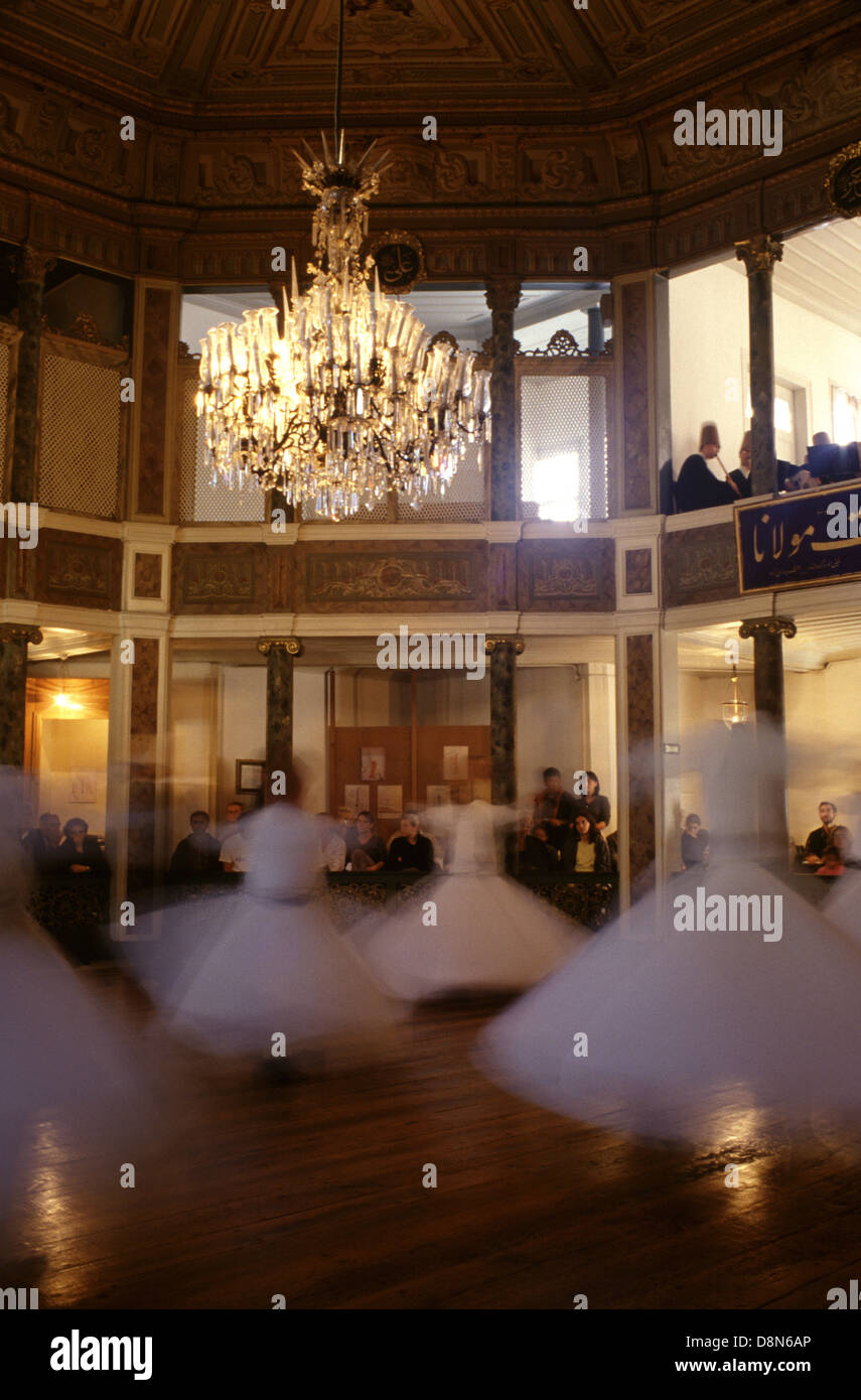 Whirling Dervish dancers performing at The Galata Mevlevihanesi, Museum of Court Literature in Beyoglu district - Stock Image