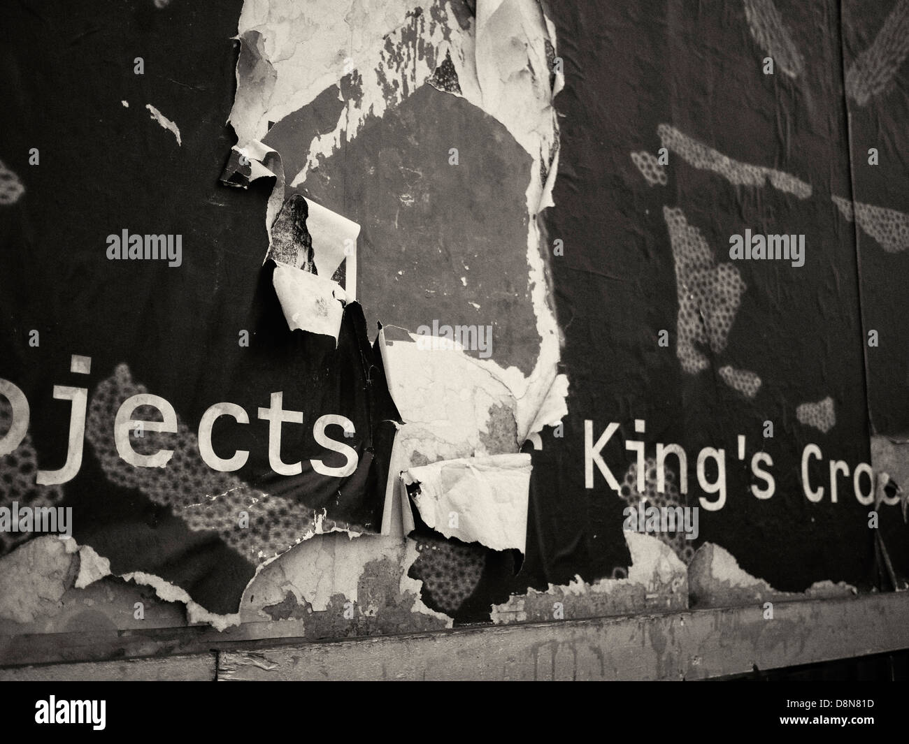 Torn poster on Goods Way, site of redevelopment of King's Cross and St Pancras stations and surrounding area, - Stock Image