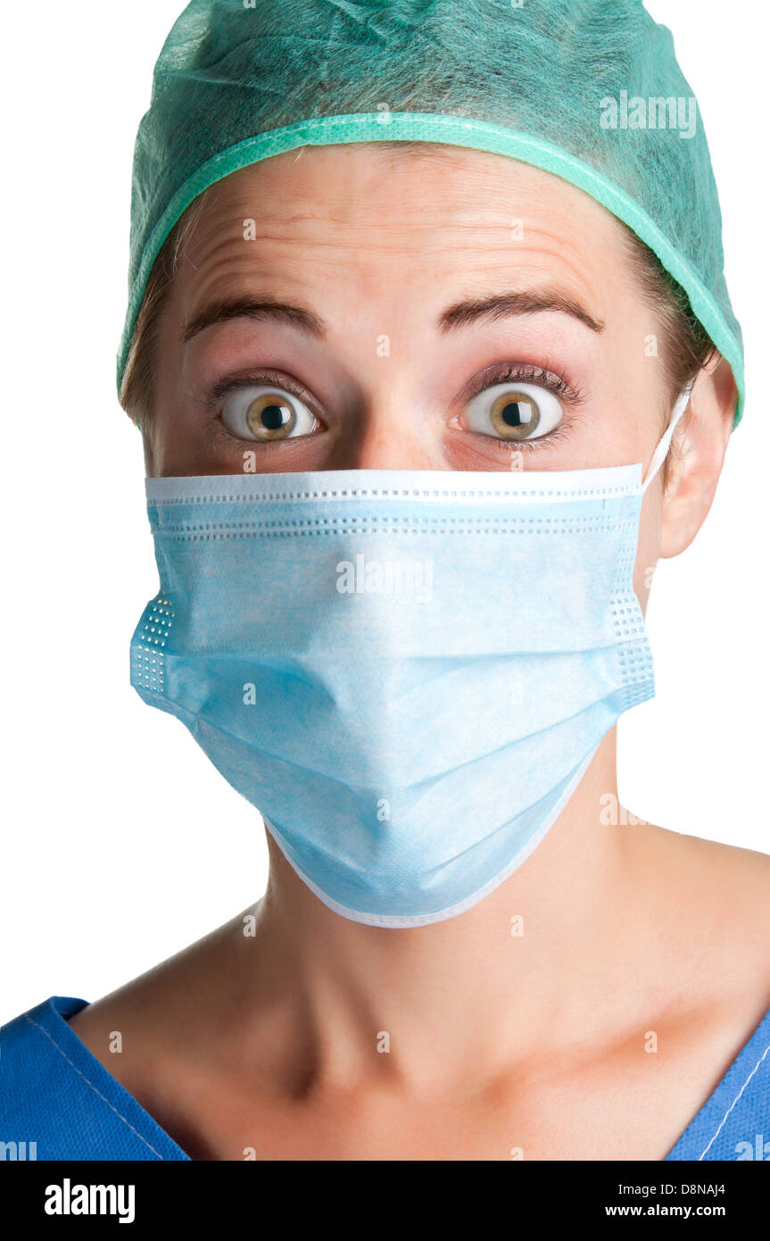 Closeup portrait of a surprised female surgeon, with face mask, isolated. - Stock Image