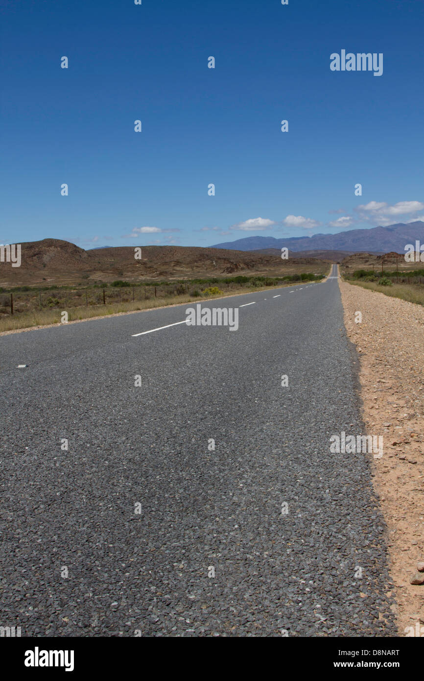 Portrait of a long straight road - Stock Image