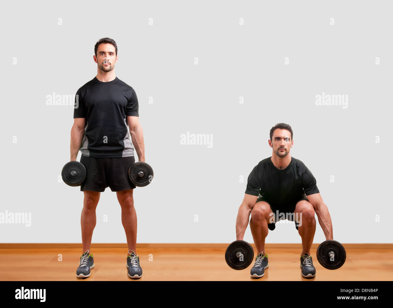 Personal Trainer doing dumbbell squat for training his legs - Stock Image