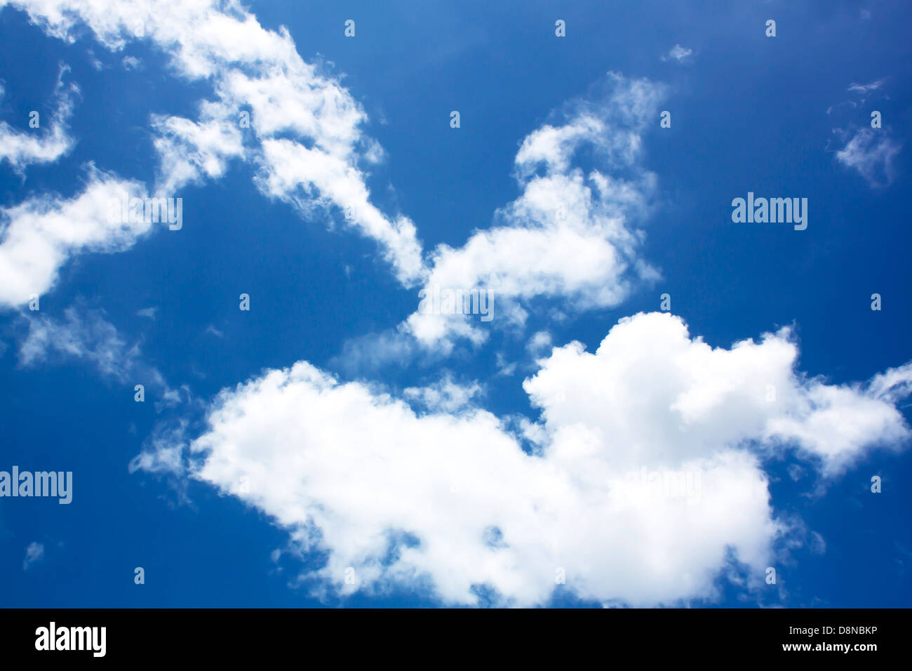 Blue sky with clouds, bright natural beauty. - Stock Image