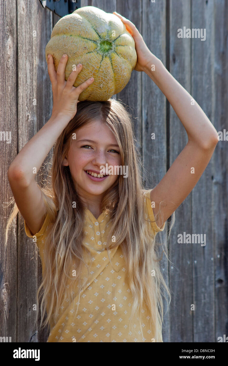 Girl Posing With A Heirloom Cantaloupe On Her Head In Front Of The Stock Photo Alamy Cantaloupe head is on facebook. alamy