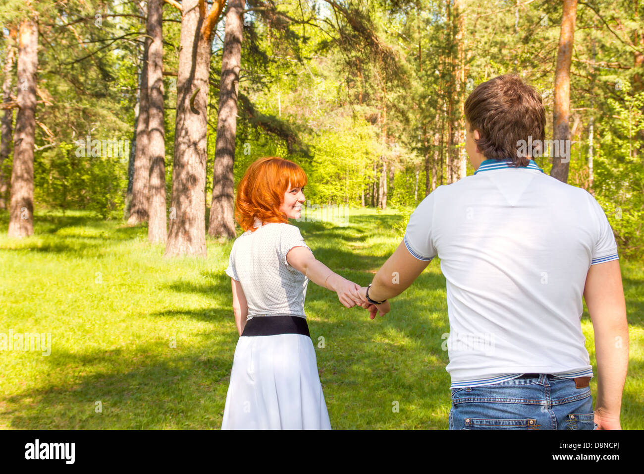 couple walking park happy people forest stock photo
