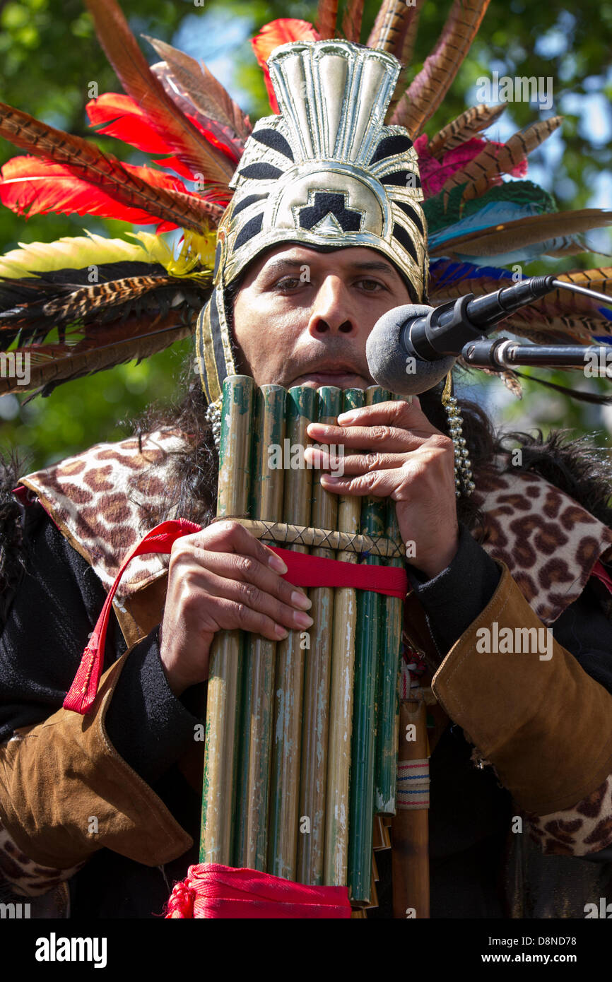 Manchester, UK. 1st June 2013. Sergio Fistely (MR) a street entertainer in Aztec Indian Native American costume - Stock Image